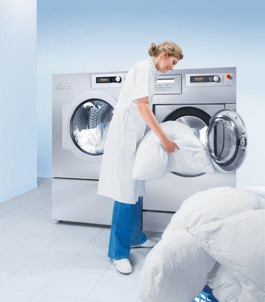 Daunen-, Federdecken und Kissen Reinigung